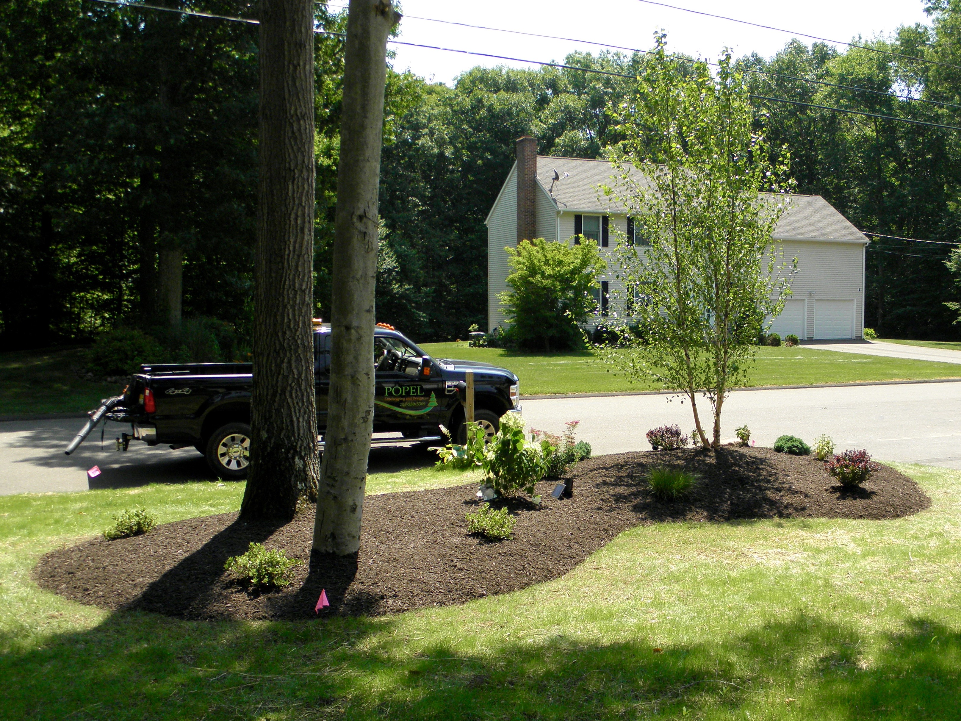 front yard island   popel landscaping and design, llc